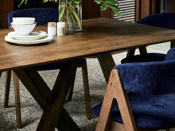 Front view of Room with Modern Dining Furniture containing Gaudi 7PCE Dining Set with Rustic Hardwood Table & Navy Blue Chairs